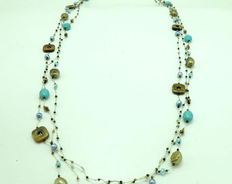 Long necklace turquoise,tiger eye and crystal hand -knotted on silk thread.