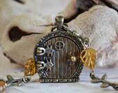 Fairy Door Locket, Garden Door Necklace, Amber Glass Leaves with Gold Inlay