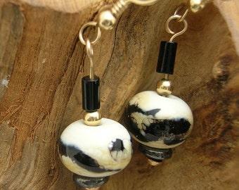 Cream and black lampwork bead earrings in gold fill