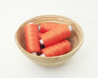 Orange polyester sewing thread. Coats Moon colour M0205. 1 reel