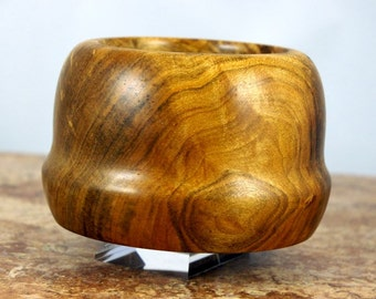 Hand Turned acorn shaped Ambrosia Maple Bowl with some worm tracks and a food safe finish.