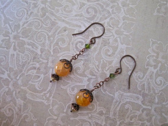 copper wire earrings with honey amber agate and green swarovski crystals