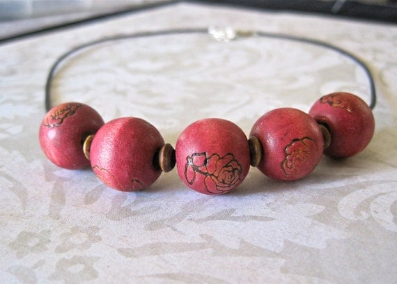 rustic wood burned beaded necklace. rose impression. dark brown leather cord.