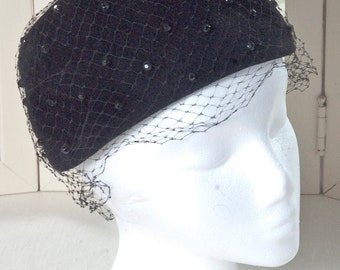 Black pillbox hat w/beaded webbing