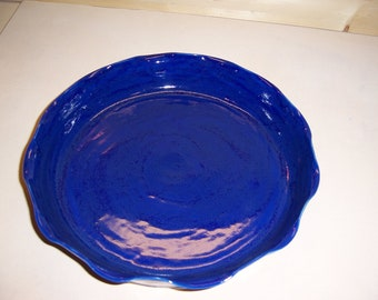 Cobalt blue stoneware pie plate with scalloped edges