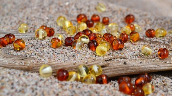 Multicolored Baltic Amber beads with drilled hole. 50 pcs