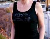 It's just a hill get over it done in vintage looking silk screen on a black workout tank top with a plain back