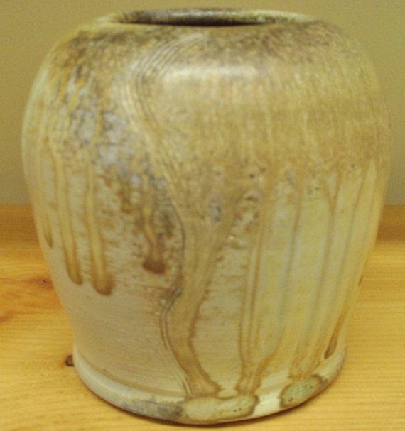 Carved Wood fired vase in natural ash glaze on porcelain clay..