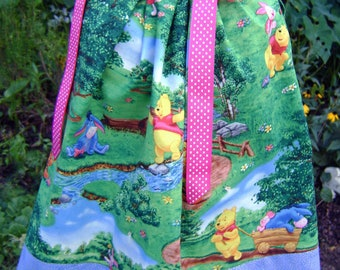 Boutique pillowcase dress featuring Winnie Pooh and friends :CH047