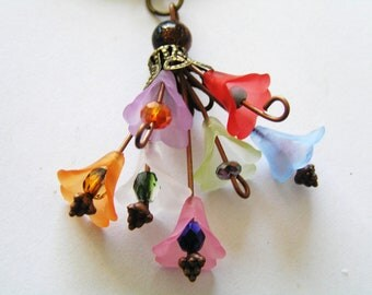 Cute Lucite Flower, Crystal, Czech Glass Bouquet Pendant with Blue and Gold Marbled Goldstone and Black Cord