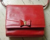 Gorgeous 80's bright red vintage Salvatore Ferragamo bag with a bow on the front - down from 80!
