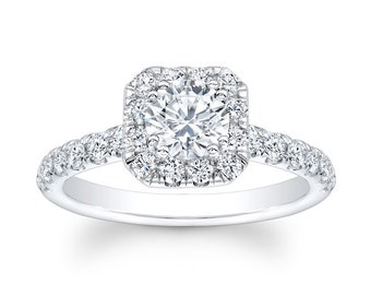 Ladies 14kt white gold diamond engagement ring with 0.60 carats of G color VS2 clarity diamonds and 1ct Round White Sapphire Ctr