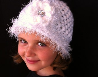 White Girls Crochet Hat in soft acrylic and irridescent  yarn .  Crystal Button in Flower with soft boa trim.