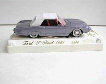 Vintage collectible Ford 1961 T-bird, Solido 4505, eggplant mauve colour, convertible
