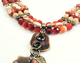 Gypsy necklace beaded in tangerine, copper brown, brass brown - brass and silver metal - shark tooth, wing, star - western - boho style