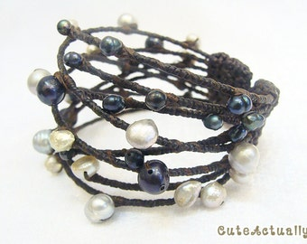 Black gray freshwater pearl with wrapped wax cord on wire bangle