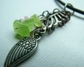 Ribcage style pendant with cog, wing and lime green glass nugget drops.