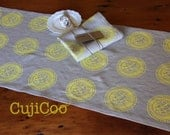 Linen table runner screen printed with yellow Artichoke design on 100% natural linen