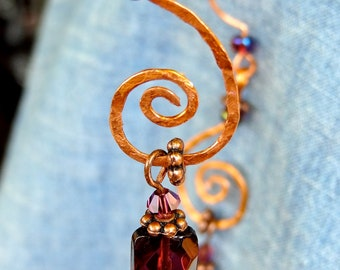 Copper swirl dangle earrings with purple accent crystals/beads from Third Time's A Charm