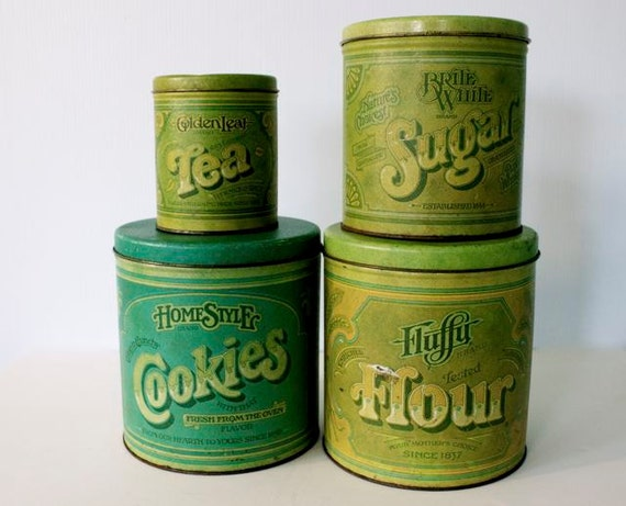 Rustic 4 Piece Vintage Tin Metal 1970s Advertising Canister Set Rusty and Green