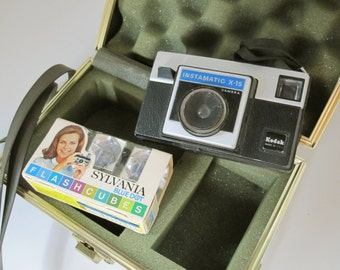 A Kodak Instamatic X-15 Camera - Carrying Case - Package of Flash Cubes - Collectible and Usable with the Right Film