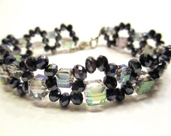 Beaded bracelet, Crystal bracelet black crystals with small and large multi squares on fishing line with a lobster claw clasp