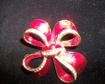 red and gold enamel and rhinestone brooch