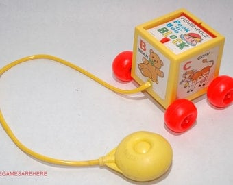 Peek a Boo Block Pull Toy from Fisher Price 1970