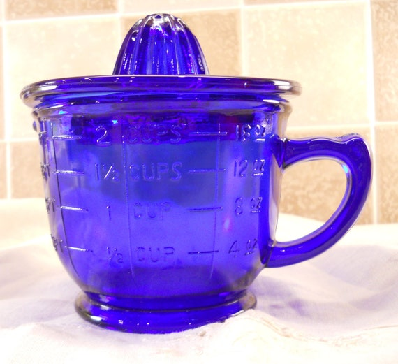 Cobalt Blue Juicer, Reamer and Measuring Cup. This is a 2 piece set.