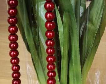 Glass red pearl necklace and earrings