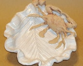 Crab on palm leaf spoon rest.