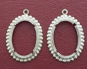 two silver plated 25x18  pendant mounting