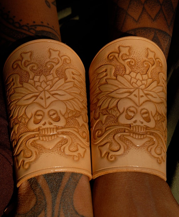 Custom item hand carved leather cuffs