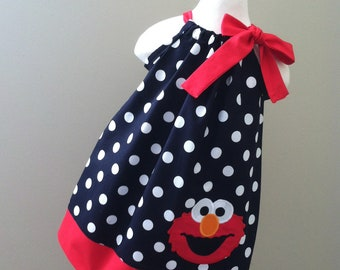 Sesame Street's Elmo in pillowcase dress