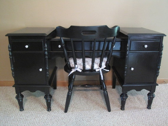 Beautifully refurbished matching black vanity and chair.
