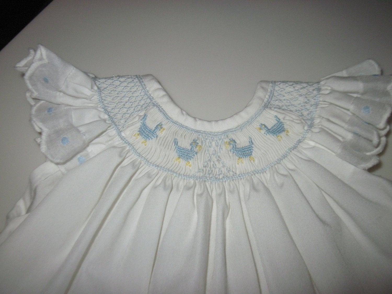 Vintage 1970s hand smocked baby dress. by TwoVintageVagabonds