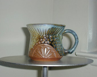Wonderful design, Redware cup or mug with multi color glazes