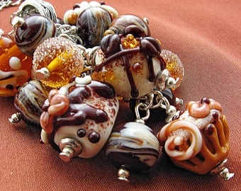 Chocolate, orange and creame colors glass lampwork pendant with cake-form beads