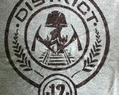 2-SIDED Hunger Games(District 12) Tribute FREE Decal