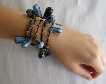 dramatic blue and black coil bracelet