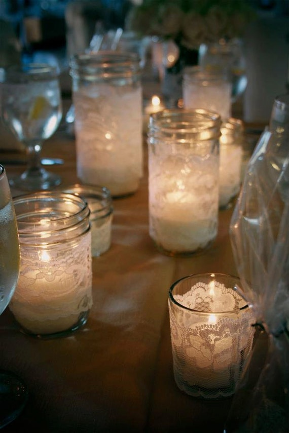 Lace wrapped ball jars and votive holders.