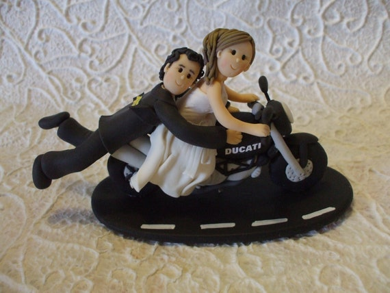 Customized  bride and groom with motorcycle wedding cake topper