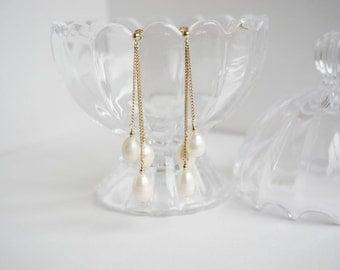 elegante - three strings rice pearl swinging earrings