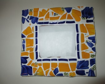 Bright yellow and blue mosaic china mirror with white grout