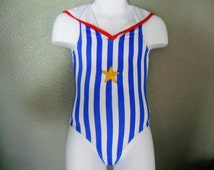 One piece girl's swimming suit--Size: 12mos, 18 mos, 24 mos/2T, 3T, 4T, 5,6,6X The size runs small, please order at least 2 size up!!!