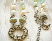 shabby chic rhinestone brass circle necklace. vintage assemblage on sterling with magnesite,  faux pearls and vintage crystals by val b.