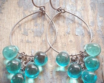teal cluster hoop earrings. teal czech glass drops on oxidized sterling silver by val b.