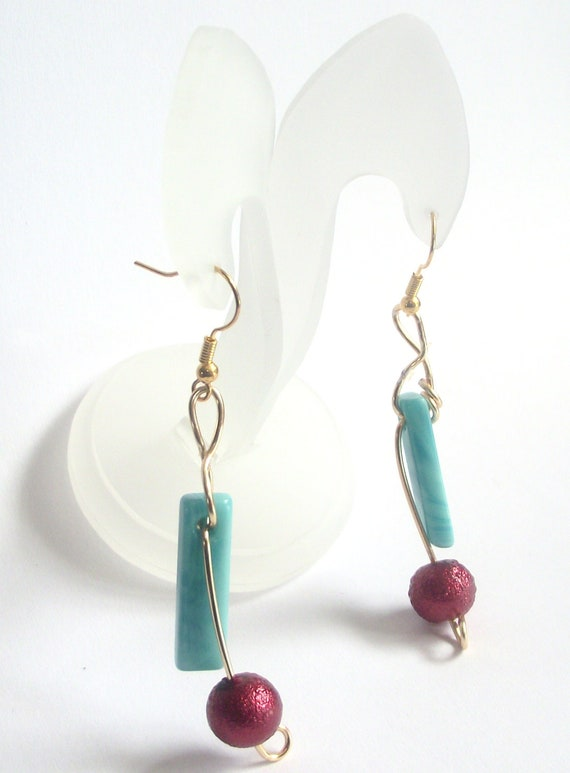 Turquoise earrings red wire wrapped