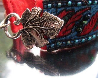 SALE Leaf cuff bracelet in vibrant red and blue with beaded accents and leaf clasp SALE
