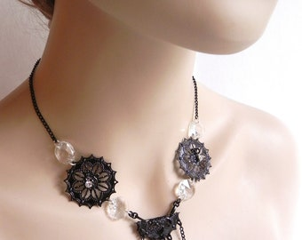Black necklace filigree ornaments and crystals- A trist with Beardsley